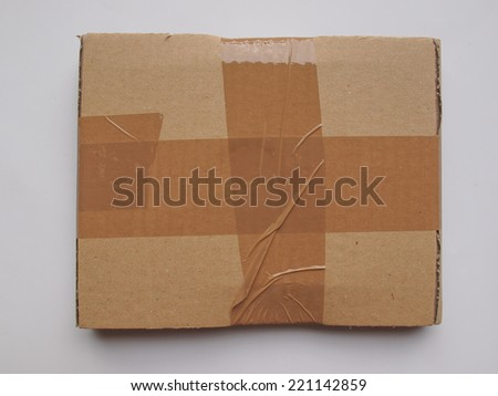 cardboard parcel sealed with adhesive tape useful as shipping concept or as background