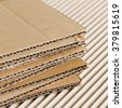 Cardboard pile on corrugated cardboard texture - stock photo