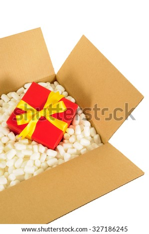 Cardboard shipping box with red gift inside  - stock photo