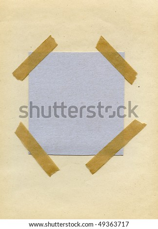 Cardboard stickied on textured recycled paper background