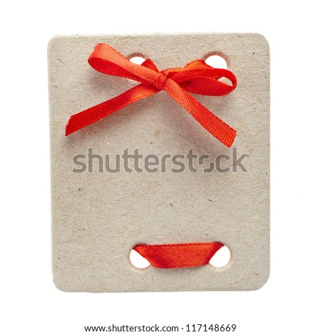 cardboard tags with red  ribbon bow isolated on white background - stock photo