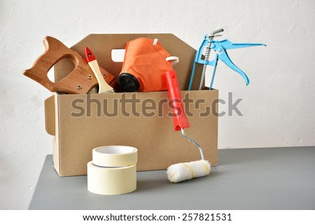 Cardboard toolbox with a set of tools - stock photo