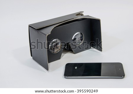 Cardboard virtual reality glasses in black with a mobile phone. Vr headset made with cardboard