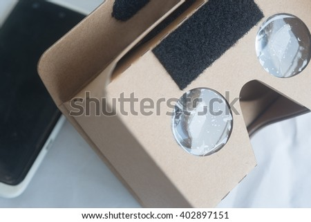 Cardboard VR glasses for watching virtual reality games and photos - stock photo