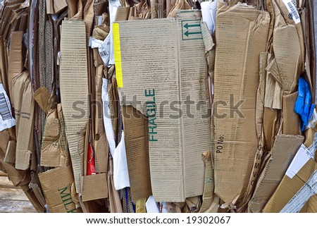 Cardboard waste bundled for recycling; background/texture - stock photo