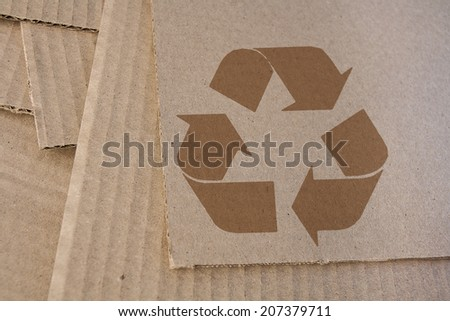 Cardboard with recycle symbol - stock photo