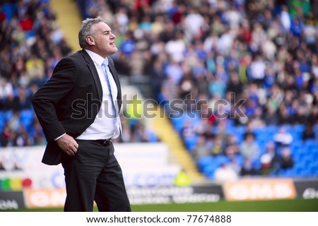 CARDIFF - APRIL 02: Dave Jones manager for Cardiff City FC reacts by the sideline during their Championship match against Derby County FC, April 02, 2011 in Cardiff, Wales.