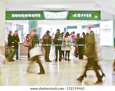 CARDIFF, WALES - MARCH 2: a Krispy Kreme fast food restaurant on March 2, 2013 in Cardiff, Wales. Krispy Kreme has 3,700 employees worldwide and had a revenue of $403m in 2012. - stock photo