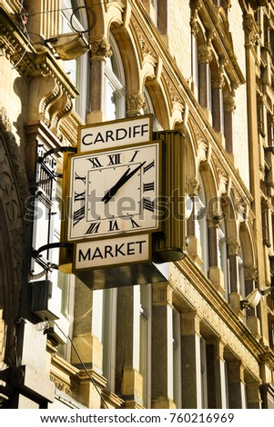 Cardiff, Wales - November 2017: Close up of the large clock on the exterior of the Cardiff Indoor Market