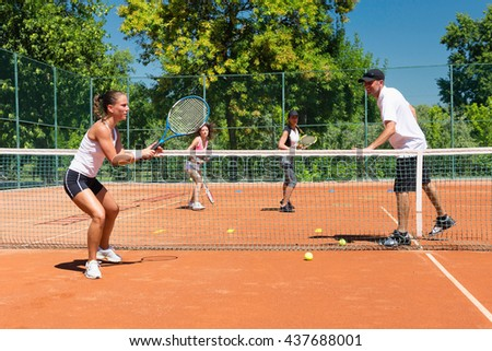Cardio tennis training - instructor working with group of young people