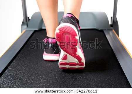 Cardio training on treadmill on pink black sport shoes - stock photo