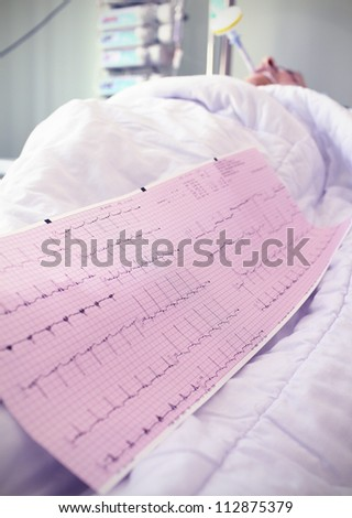 cardiogram at the bedside. medical concept - stock photo