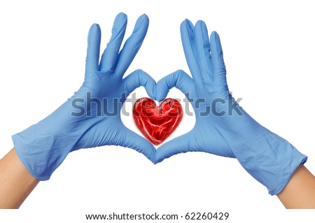 cardiologist in blue gloves saving life of all his patients - stock photo