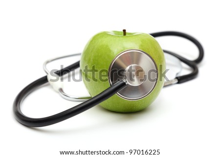 cardiology: stethoscope and green apple isolated on the white background - stock photo