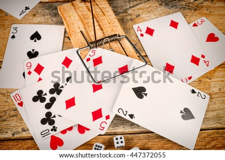 Cards and dice in a conceptual shot depicting compulsive gambling - stock photo