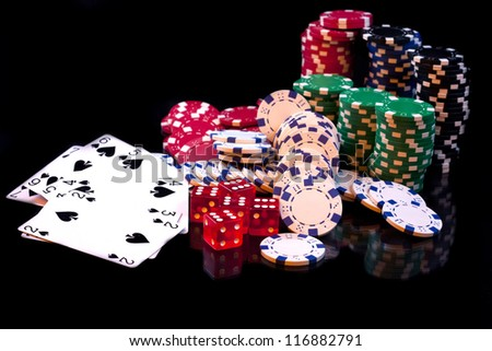 cards, dice and poker chips, isolated on black composition