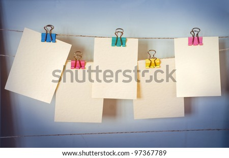 Cards hang on a clothesline on a rope - stock photo