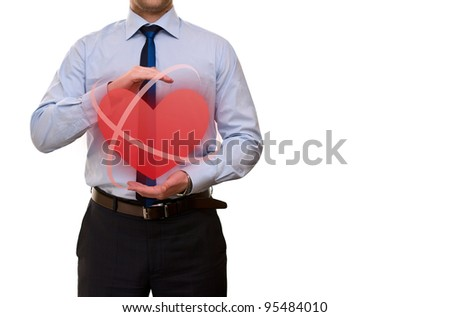 Care concept. Man with heart - stock photo