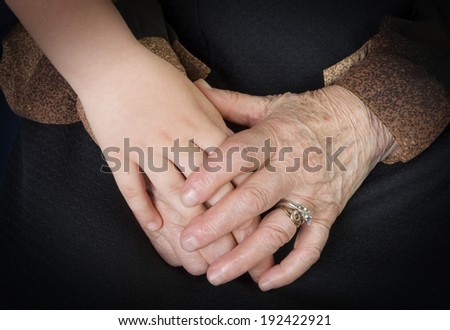 Care concept, young and elder hands