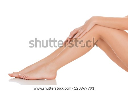 care for beautiful woman body. Perfect long female legs against white background