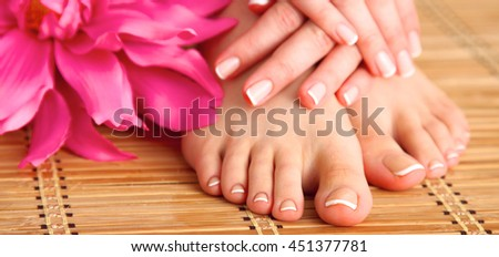 Care for beautiful woman legs on the floor - stock photo
