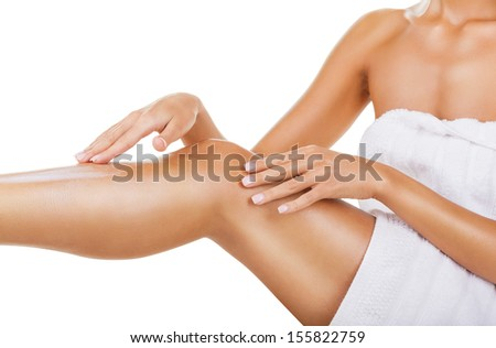 Care for female legs isolated on white background - stock photo