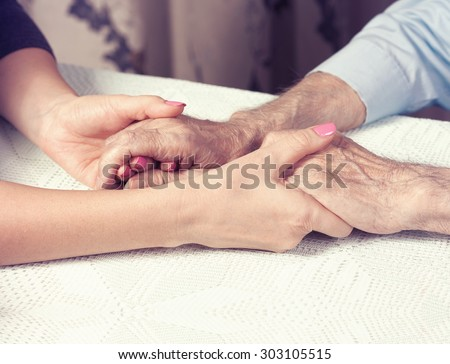 Care is at home of elderly. Space for text. Senior man, with their caregiver at home. Concept of health caring for elderly old people, disabled. Elderly man.  - stock photo