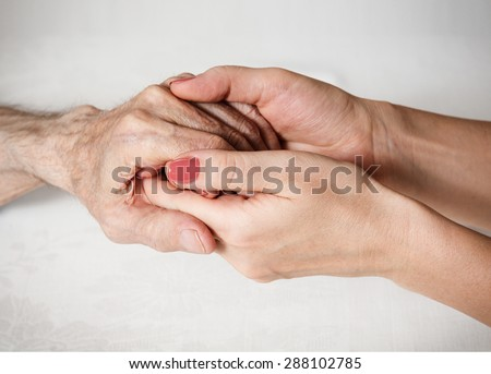 Care is at home of elderly. Space for text. Senior man, woman with their caregiver at home. Concept of health care for elderly old people, disabled. Elderly man.  - stock photo