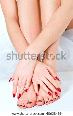 Care of beautiful female legs on white background