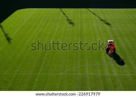 Care of the football pitch. - stock photo
