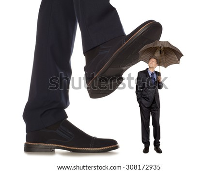 Cared small businessman under big leg his boss, isolated on white background - stock photo