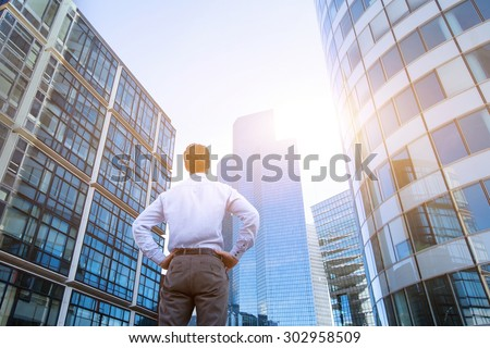career concept, business background, man looking at office buildings - stock photo