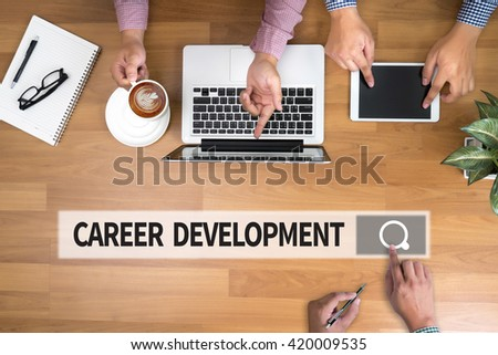CAREER DEVELOPMENT man touch bar search and Two Businessman working at office desk and using a digital touch screen tablet and use computer, top view - stock photo