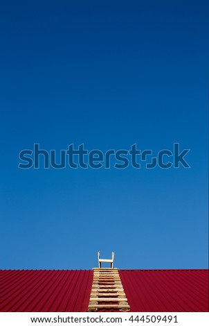 career ladder. blue sky, red roof and a wooden ladder. the concept of a career in construction. copy space for your text - stock photo