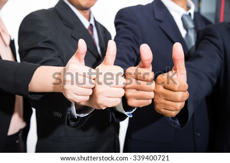 Career success ,Businessman thumb up for like your good job. - stock photo