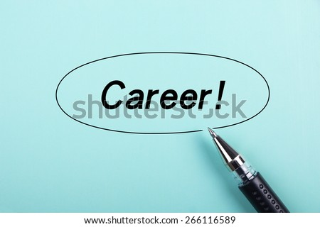Career text is on blue paper with black ball-point pen aside. - stock photo