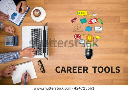 CAREER TOOLS Business team hands at work with financial reports and a laptop - stock photo