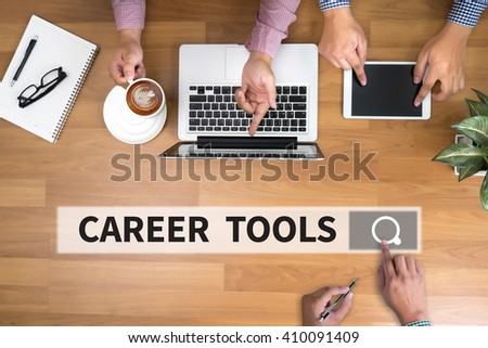 CAREER TOOLS man touch bar search and Two Businessman working at office desk and using a digital touch screen tablet and use computer objects on the right, top view - stock photo
