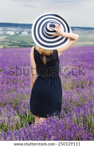 Carefree adorable girl in fairy field of lavender. Summer freedom enjoy concept - stock photo