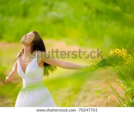 Carefree adorable girl with arms out in field. summer freedom andjoy concept. - stock photo