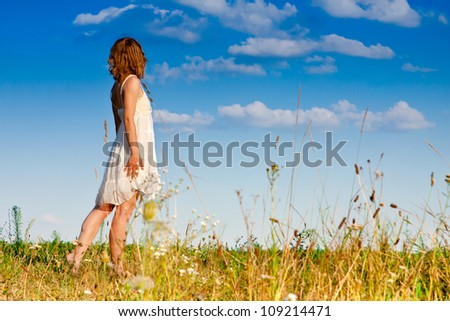 carefree adorable woman in field - stock photo