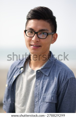 Carefree and free man smile to you, asian - stock photo