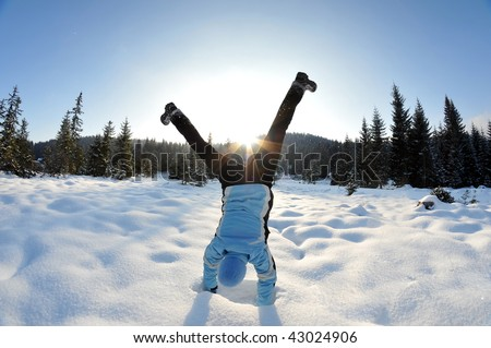 Carefree and happy female in the snowy nature - stock photo