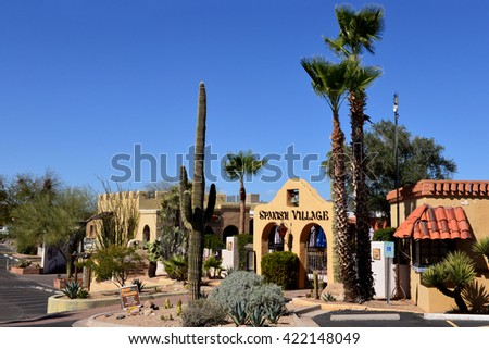 CAREFREE, AZ, USA - FEB 22, 2016: Entrance to the Spanish Village, a period looking shopping area in Carefree, Arizona, with local cactus and other vegetation. - stock photo