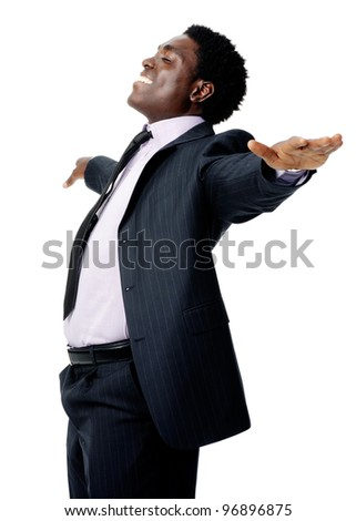 carefree black businessman stands with his arms out in a relaxed pose isolated on white - stock photo
