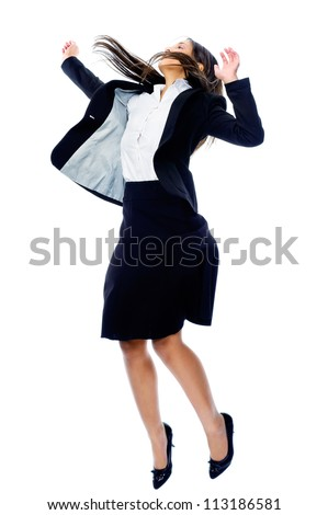 Carefree celebrating businesswoman jumping with joy, victory and happiness while smiling in a suit isolated on white background - stock photo