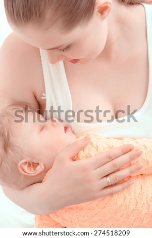 Carefree childhood .Small baby boy sleeping on the chest of his happy mother - stock photo