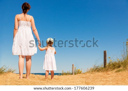 carefree family on the way to the sea - stock photo