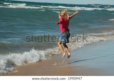 Carefree girl frolicking in the beach surf