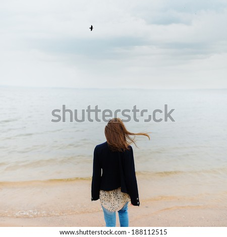 carefree girl standing on the beach